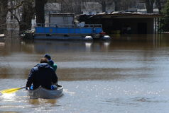 Flooded Rescue. Kayakers head to the rescue during flooding in Grand Rapids, Michigan royalty free stock photo