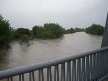 Flooded river in central Europe from a bridge.Floods and storms are very common  due to climate change. Water, flood. Natural photo Royalty Free Stock Photos