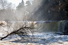 Flooded river and waterfall Royalty Free Stock Photos