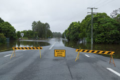 Flooded road. Flooded suburban road with road block in Australia Stock Photo