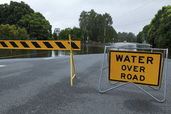 Flooded road. Flooded australian road with road block Royalty Free Stock Photos
