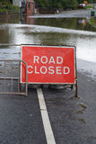 Flooded Road. A flooded road in Gloucestershire, with Road Closed sign royalty free stock photos