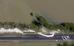 Flooded road. Car driving on flooded road Royalty Free Stock Image