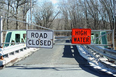 Flooded road closed sign on a bridge Stock Photography