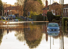Flooded road junction. A flooded road junction with a drowned car Royalty Free Stock Images