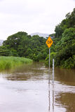 Flooded road in Queensland, Australia Stock Photos
