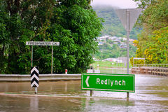 Flooded road and road sign in Australia royalty free stock photos