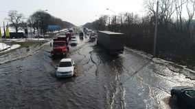 Flooded road section with cars stock footage