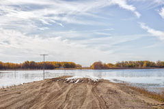 Flooded rural gravel road Stock Photos