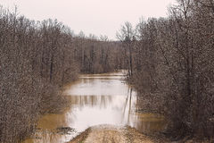 Flooded rural road Stock Image