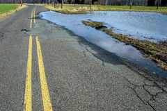 Flooded Rural Two Lane Country Road and Wet Fields stock photo