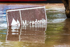 Flooded Sign in Colombia. Sign to the indigenous community of Macedonia flooded by the Amazon River near Leticia, Colombia Stock Photos