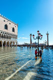Flooded St. Marks Square in Venice, Italy. VENICE, ITALY - 17 OCTOBER 2015: St. Marks Square (Piazza San Marco) during high tide (acqua alta) in Venice, Italy Stock Images