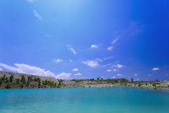 Flooded stone quarry. Crimea. Skalistoe, Bakhchisaray region. Lake in quarry. Royalty Free Stock Photo