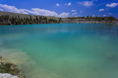 Flooded stone quarry. Crimea. Skalistoe village, Bakhchisaray region. Lake in quarry Royalty Free Stock Photography