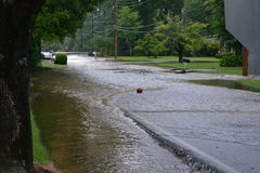 Flooded Street. Basketball floating down a flooded street stock photography