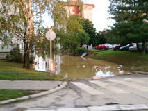 Flooded street in city, state after floods Stock Photography