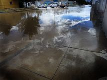 Flooded Street in City with Workers Royalty Free Stock Photography