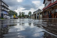 Flooded street after torrential rain. Sarbinowo, Poland - August 2017 : Heavily flooded street after extremely heavy rainfall royalty free stock images