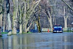 Flooded Suburb Street. Chicago Suburbs in Flood. Weather Distasters Photo Collection. Truck in the Water Stock Images