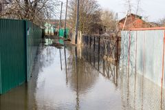 Flooded summer cottages and houses during the spring high water stock image