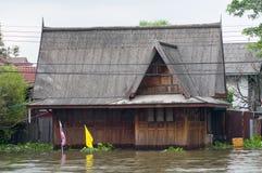 Flooded teak house in Bangkok, Thailand Stock Images