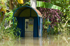 Flooded telephone booth Royalty Free Stock Image