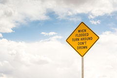When flooded turn around. Road sign Stock Photo