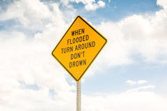 When flooded turn around. Road sign Royalty Free Stock Images