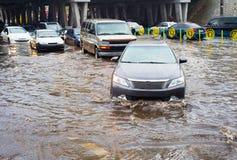 Flooded urban road Royalty Free Stock Photo