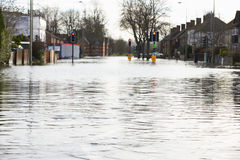 Flooded Urban Road With Traffic Lights Stock Photography