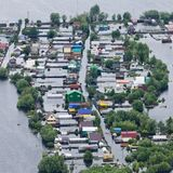 Flooded village in lowland of Great river. Aerial View of same houses in flooded area near of great river stock images