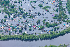 Flooded village in lowland of Great river Royalty Free Stock Images