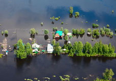 Flooded village in lowland of Great river Stock Photos