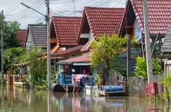 Flooded village road in Thailand Royalty Free Stock Photos