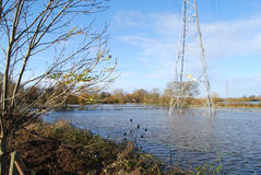 Flooded water meadow in autumn. Floodplain under water at West Parley Royalty Free Stock Photo