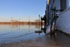 Flooded waters outside building in Aurora, Indiana. February 2018 flooding of Aurora, Indiana from the Ohio River. Flood waters outside building. Sandbags hold Royalty Free Stock Photography