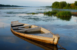 The flooded wooden boat Stock Photo