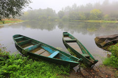 Flooded wooden boats on river Royalty Free Stock Photo