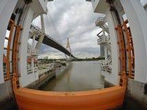Floodgate with Bhumibol Bridge Royalty Free Stock Image