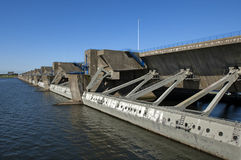 Floodgates of the dam Haringvlietdam, a Delta work. Netherlands, province South Holland, between the small town Hellevoetsluis and village Stellendam is the Stock Photo