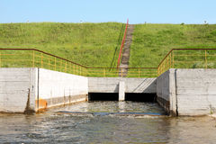 Floodgates of a small dam Stock Photos