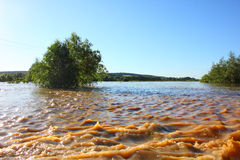 Flooding. A river overflowed its banks after spring rain Royalty Free Stock Photo