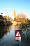 Flooding. In england shropshire at shrewsbury on river severn. bridge and church in background, water with cyclist sign post in foreground stock photos