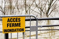 Flooding Access closed sign France. How to get around in Paris by public transport? Flooded banks and the swollen Seine river. France on alert after days of royalty free stock photography