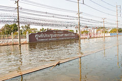 Flooding in Bangkok. Bangkok, Thailand - November 14: The street in front of Thammasat University, Rangsit Campus has been flooding the Internet as the car can Stock Photography