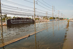 Flooding in Bangkok. Bangkok, Thailand - November 14: The street in front of Thammasat University, Rangsit Campus has been flooding the Internet as the car can Royalty Free Stock Photo