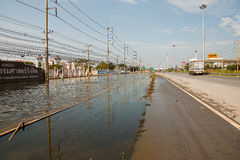 Flooding in Bangkok. Bangkok, Thailand - November 14: The street in front of Thammasat University, Rangsit Campus has been flooding the Internet as the car can royalty free stock photography