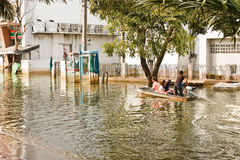 Flooding in Bangkok. Bangkok, Thailand - November 14: The entrance to the Nava Nakorn Industrial Park is a high flood. I need a boat to travel in - from stock image