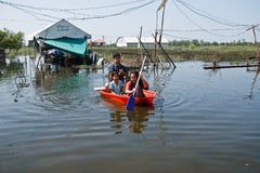 Flooding in Bangkok Thailand. Bangkok, Thailand - November 16: People flooded the ship to travel November 16, 2011 at Pathum Thani. Bangkok, which is the worst Royalty Free Stock Image